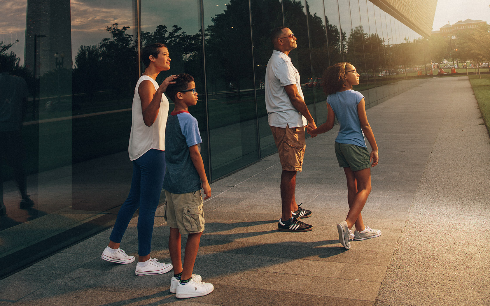 Family walking outside the National Museum of African American History and Culture