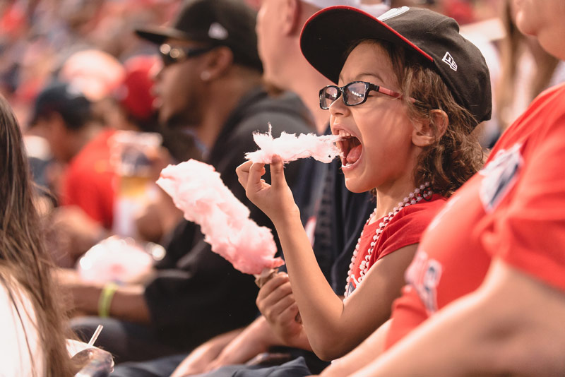 Young fan eating cotton candy at Washington Nationals game - Kid-friendly things to do in Washington, DC