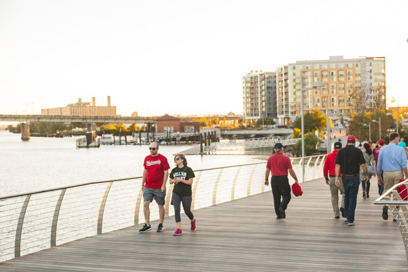 Summer evening on Anacostia Riverwalk Trail in Capitol Riverfront - Waterfront activities in Washington, DC