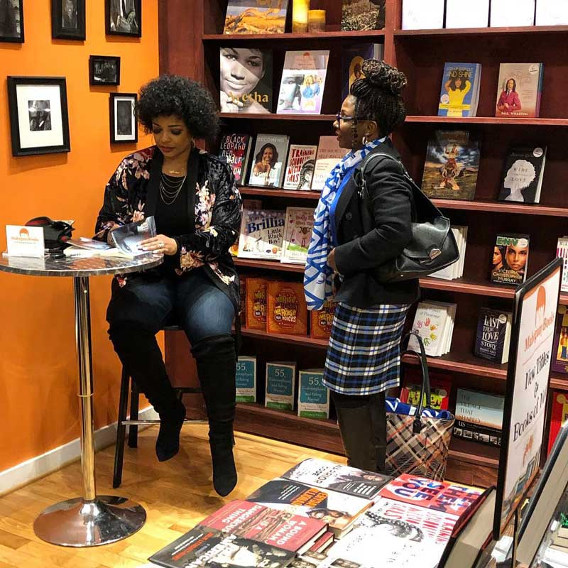 Shoppers at MahoganyBooks - Independent bookstore in DC's Anacostia neighborhood