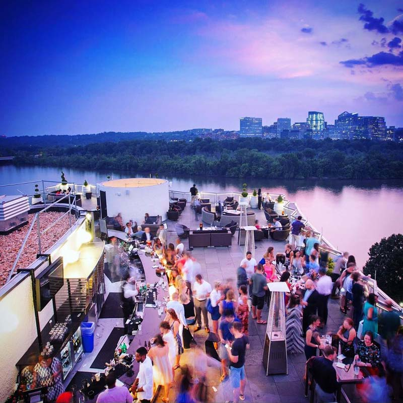 @watergatehotel - Top of the Gate rooftop bar at The Watergate Hotel - Sunset overlooking Potomac River in Washington, DC
