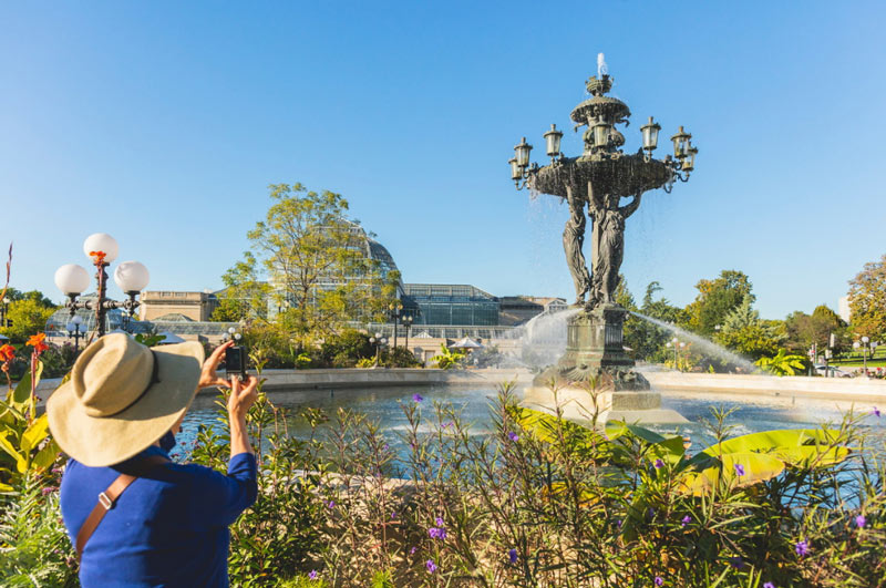 Woman taking photo at Bartholdi Fountain on Capitol Hill - Parks in Washington, DC