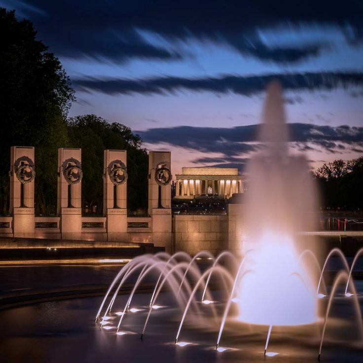 @dmorrocco - World War II Memorial at night with Lincoln Memorial - Monuments and memorials on the National Mall in Washington, DC