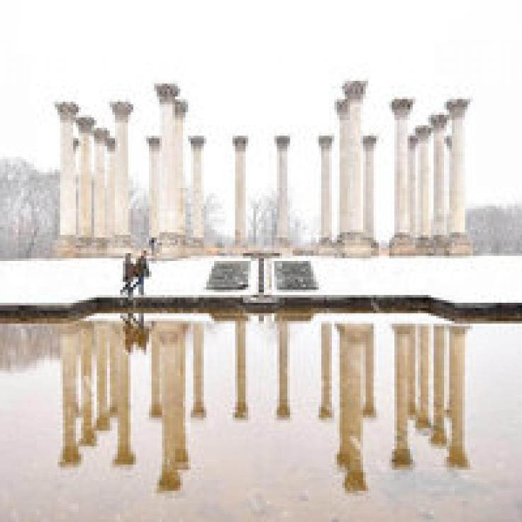 @jraefoto - Couple walking along National Capitol Columns in snowstorm at National Arboretum - Date ideas in Washington, DC