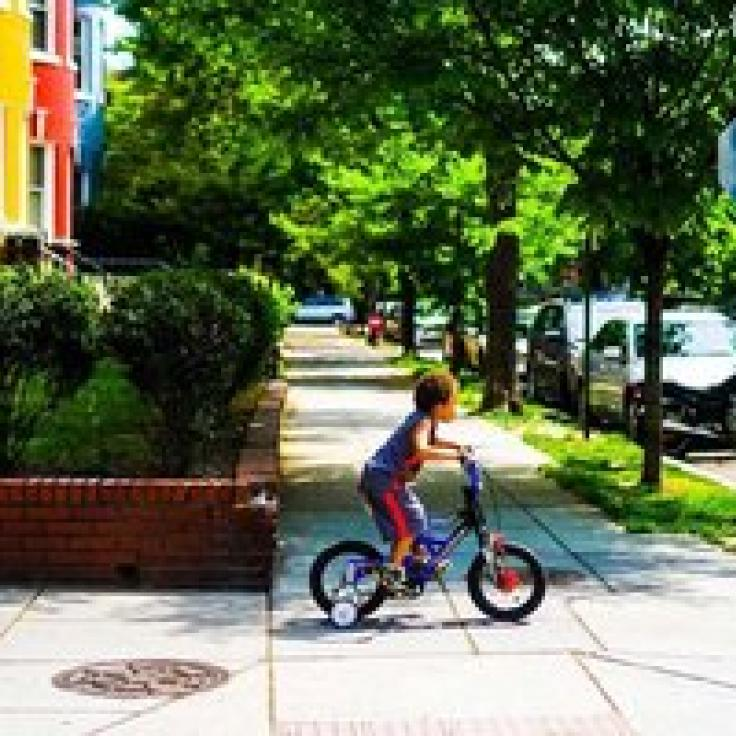 @maisiesview - Child riding bicycle in Adams Morgan neighborhood - Things to do in Washington, DC