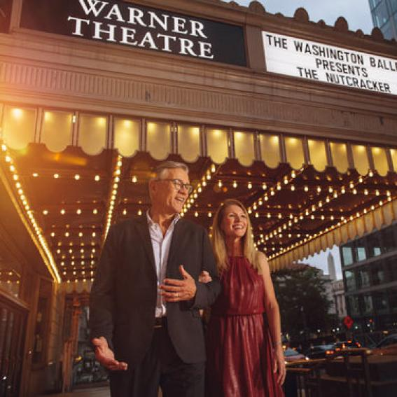 couple leaving the warner theater
